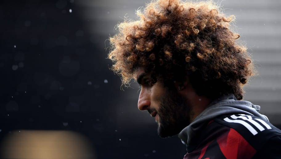MANCHESTER, ENGLAND - SEPTEMBER 30: Marouane Fellaini of Manchester United warms up prior to the Premier League match between Manchester United and Crystal Palace at Old Trafford on September 30, 2017 in Manchester, England.  (Photo by Laurence Griffiths/Getty Images)