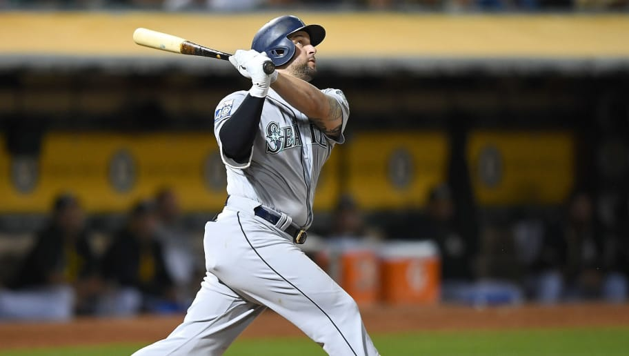 OAKLAND, CA - SEPTEMBER 26:  Yonder Alonso #10 of the Seattle Mariners swings and watches the flight of his ball as he hits a two-run homer against the Oakland Athletics in the top of the fourth inning at Oakland Alameda Coliseum on September 26, 2017 in Oakland, California.  (Photo by Thearon W. Henderson/Getty Images)