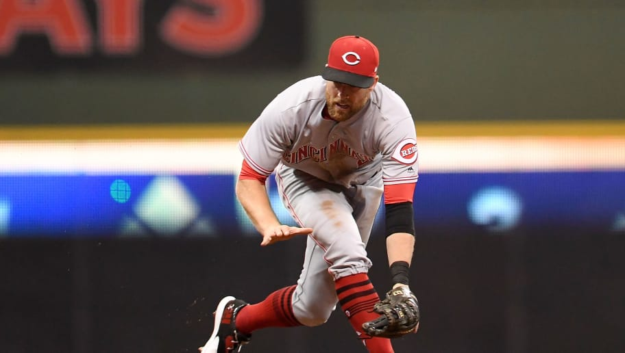 MILWAUKEE, WI - SEPTEMBER 26:  Zack Cozart #2 of the Cincinnati Reds fields a ground ball during the seventh inning of a game against the Milwaukee Brewers at Miller Park on September 26, 2017 in Milwaukee, Wisconsin.  (Photo by Stacy Revere/Getty Images)