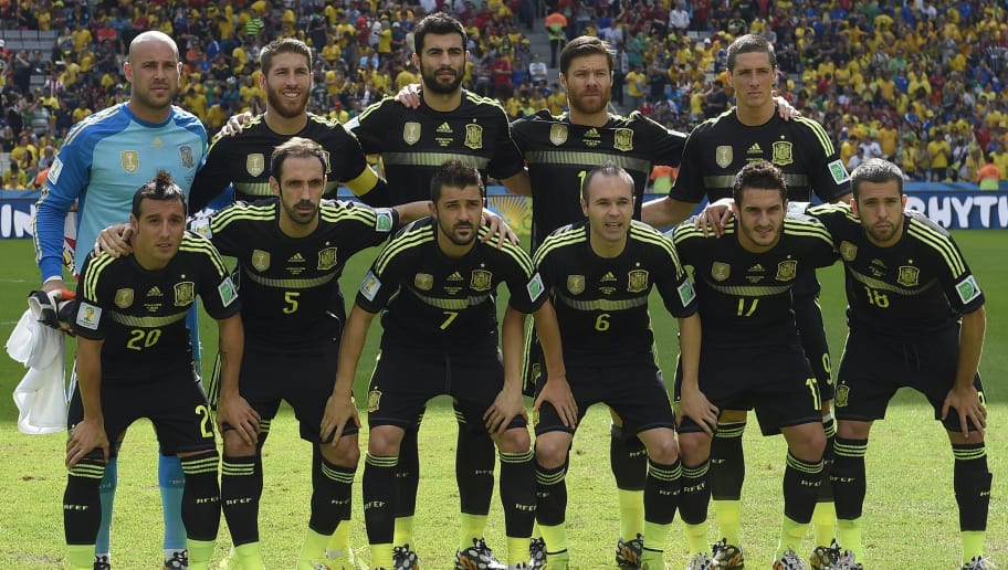 The Spanish team (Top Row L-R) Spain's goalkeeper Pepe Reina, Spain's defender Sergio Ramos, Spain's defender Raul Albiol, Spain's midfielder Xabi Alonso, Spain's forward Fernando Torres (Bottom Row L-R) Spain's midfielder Santiago Cazorla, Spain's defender Juanfran, Spain's forward David Villa, Spain's midfielder Andres Iniesta, Spain's Spain's midfielder Koke, Spain's defender Jordi Alba pose for a team picture before the start of a Group B match between Australia and Spain at the Baixada Arena in Curitiba during the 2014 FIFA World Cup on June 23, 2014.   AFP PHOTO / LLUIS GENE        (Photo credit should read LLUIS GENE/AFP/Getty Images)
