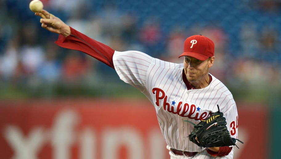 PHILADELPHIA, PA - AUGUST 04: Starting pitcher Roy Halladay #34 of the Philadelphia Phillies delivers a pitch in the first inning against the Washington Nationals at Citizens Bank Park on September 4, 2013 in Philadelphia, Pennsylvania. (Photo by Drew Hallowell/Getty Images)