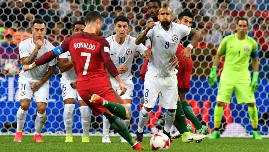 Portugal's forward Cristiano Ronaldo shoots a free kick during the 2017 Confederations Cup semi-final football match between Portugal and Chile at the Kazan Arena in Kazan on June 28, 2017. / AFP PHOTO / Alexander NEMENOV        (Photo credit should read ALEXANDER NEMENOV/AFP/Getty Images)