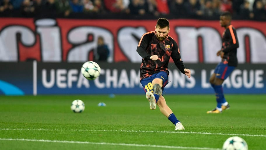 Barcelona's Argentinian forward Lionel Messi kicks the ball as he warms up prior to the UEFA Champions League group D football match between FC Barcelona and Olympiakos FC at the Karaiskakis stadium in Piraeus near Athens on October 31, 2017.  / AFP PHOTO / LOUISA GOULIAMAKI        (Photo credit should read LOUISA GOULIAMAKI/AFP/Getty Images)