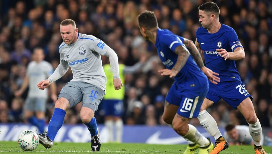 Everton's English striker Wayne Rooney (L) passes the ball during the English League Cup fourth round football match between Chelsea and Everton at Stamford Bridge in London on October 25, 2017. / AFP PHOTO / Glyn KIRK / RESTRICTED TO EDITORIAL USE. No use with unauthorized audio, video, data, fixture lists, club/league logos or 'live' services. Online in-match use limited to 75 images, no video emulation. No use in betting, games or single club/league/player publications.  /         (Photo credit should read GLYN KIRK/AFP/Getty Images)