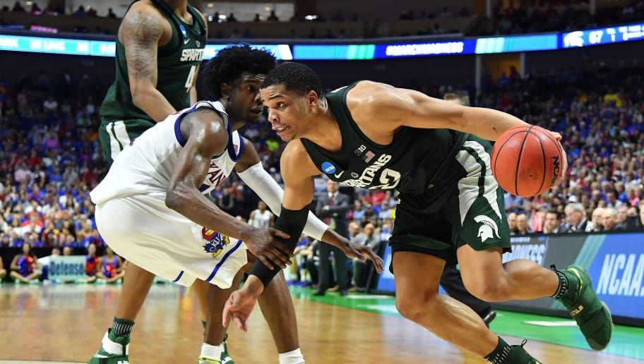 TULSA, OK - MARCH 19: Miles Bridges #22 of the Michigan State Spartans drives to the basket defended by Josh Jackson #11 of the Kansas Jayhawks during the second round of the 2017 NCAA Men's Basketball Tournament at BOK Center on March 19, 2017 in Tulsa, Oklahoma.  (Photo by J Pat Carter/Getty Images)