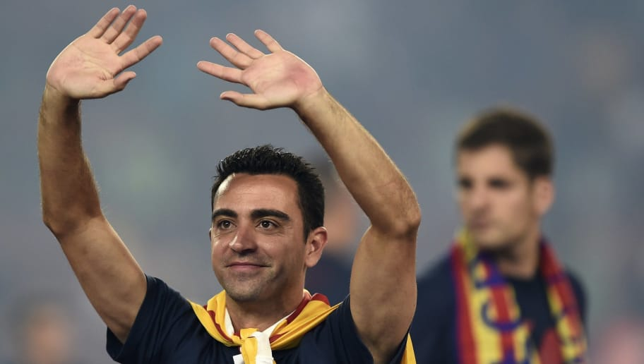 Barcelona's midfielder Xavi Hernandez waves as he takes part in the celebrations held for their victory over Juventus, one day after the UEFA Champions League final football, at the Camp Nou stadium in Barcelona on June 7, 2015. Luis Suarez and Neymar scored second-half goals to give Barcelona a 3-1 Champions League final victory over Juventus on June 6, 2015 as the Spaniards became the first team to twice win the European treble. AFP PHOTO/ JOSEP LAGO        (Photo credit should read JOSEP LAGO/AFP/Getty Images)