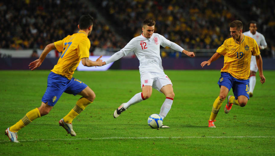 STOCKHOLM, SWEDEN - NOVEMBER 14: Carl Jenkinson of England in action with Behrang Safari and Alex Kacaniklic of Sweden during the international friendly match between Sweden and England at the Friends Arena on November 14, 2012 in Stockholm, Sweden.  (Photo by Michael Regan/Getty Images)