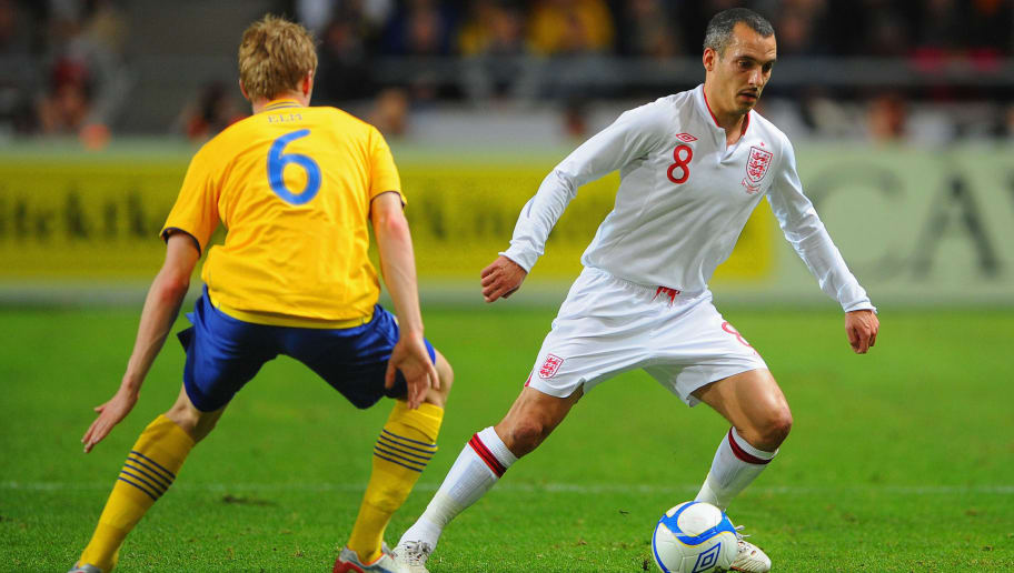 STOCKHOLM, SWEDEN - NOVEMBER 14: Leon Osman of England in action with Rasmus Elm of Sweden during the international friendly match between Sweden and England at the Friends Arena on November 14, 2012 in Stockholm, Sweden.  (Photo by Michael Regan/Getty Images)