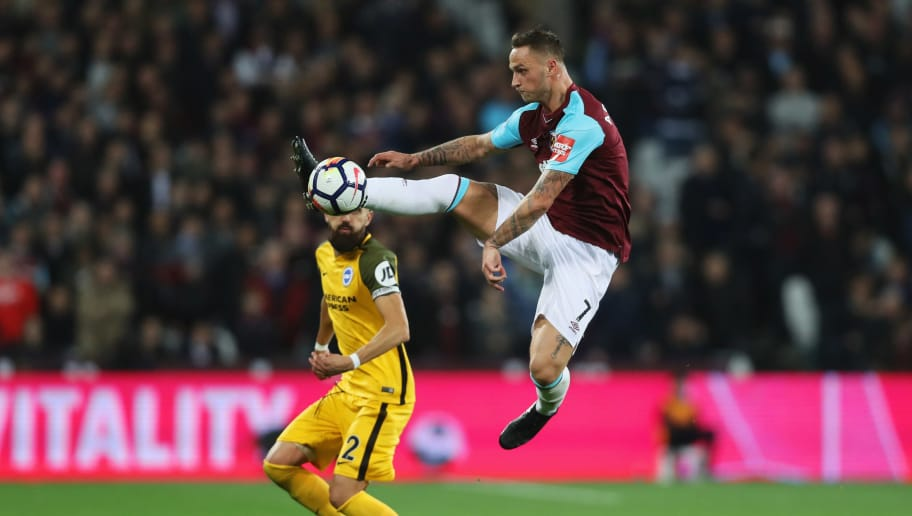 LONDON, ENGLAND - OCTOBER 20:  Marko Arnautovic of West Ham United jumps to control the ball ahead of Bruno Saltor of Brighton and Hove Albion during the Premier League match between West Ham United and Brighton and Hove Albion at London Stadium on October 20, 2017 in London, England.  (Photo by Dan Istitene/Getty Images)