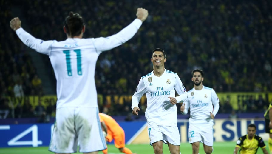 DORTMUND, GERMANY - SEPTEMBER 26:  Cristiano Ronaldo of Real Madrid celebrates scoring his sides second goal with Gareth Bale of Real Madrid during the UEFA Champions League group H match between Borussia Dortmund and Real Madrid at Signal Iduna Park on September 26, 2017 in Dortmund, Germany.  (Photo by Alex Grimm/Bongarts/Getty Images,)