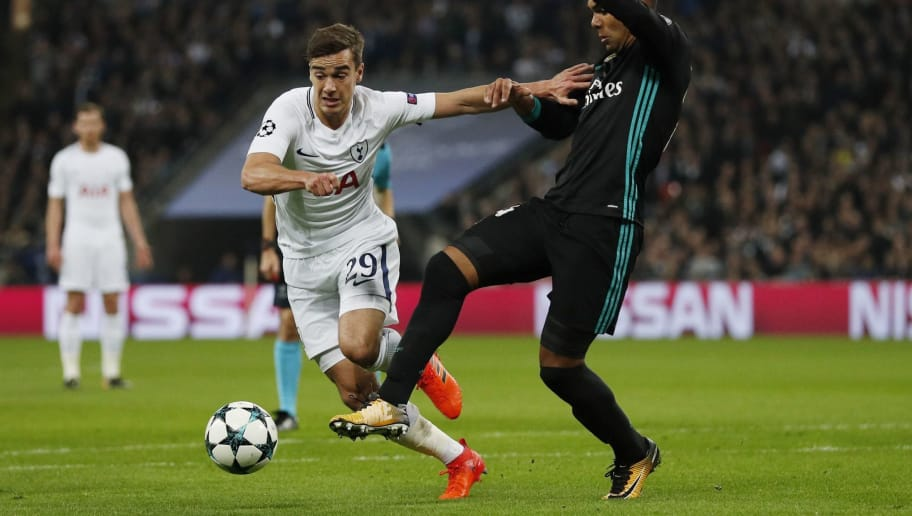 Tottenham Hotspur's English midfielder Harry Winks (L) vies with Real Madrid's Brazilian midfielder Casemiro during the UEFA Champions League Group H football match between Tottenham Hotspur and Real Madrid at Wembley Stadium in London, on November 1, 2017. / AFP PHOTO / Adrian DENNIS        (Photo credit should read ADRIAN DENNIS/AFP/Getty Images)