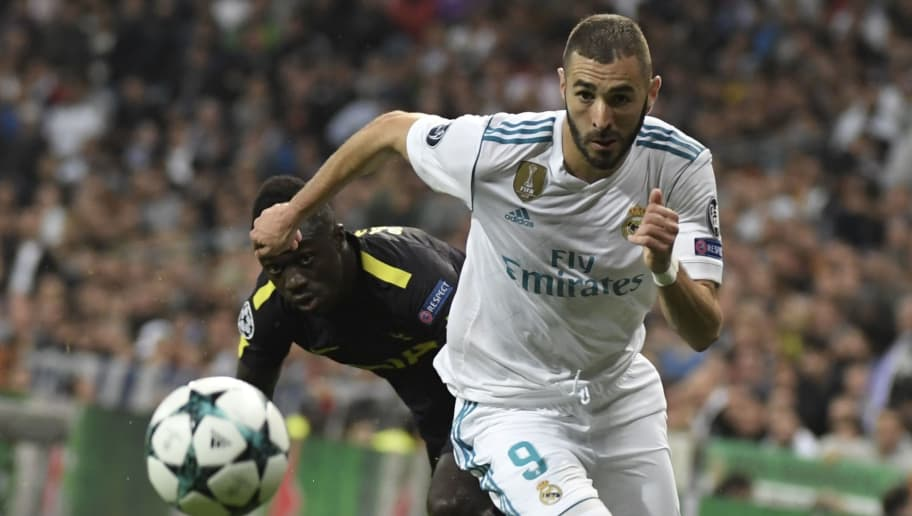 Real Madrid's French forward Karim Benzema (R) vies with Tottenham Hotspur's Colombian defender Davinson Sanchez during the UEFA Champions League group H football match Real Madrid CF vs Tottenham Hotspur FC at the Santiago Bernabeu stadium in Madrid on October 17, 2017. / AFP PHOTO / GABRIEL BOUYS        (Photo credit should read GABRIEL BOUYS/AFP/Getty Images)