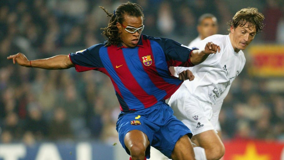 BARCELONA, SPAIN - FEBRUARY 1:  Edgar Davids of Barcelona and Mikel of Albacete in action during the La Liga match between FC Barcelona and Albacete played at the Nou Camp February 1, 2004 in Barcelona, Spain. (Photo by Firo Foto/Getty Images)