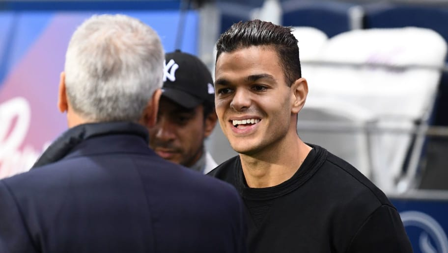 Paris Saint-Germain's French midfielder Hatem Ben Arfa (R) smiles prior to the French L1 football match between Paris Saint-Germain (PSG) and Nice (OGC Nice) on October 27, 2017, at the Parc des Princes stadium in Paris. / AFP PHOTO / FRANCK FIFE        (Photo credit should read FRANCK FIFE/AFP/Getty Images)