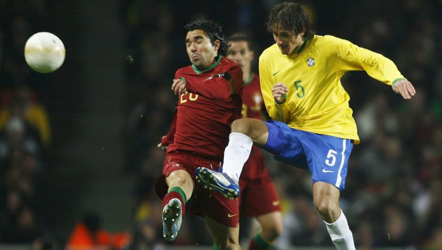 LONDON - FEBRUARY 06:  Deco of Portugal is challenged by Edmilson of Brazil during the International friendly match between Brazil and Portugal at the Emirates Stadium on February 6, 2006 in London, England.  (Photo by Clive Mason/Getty Images)