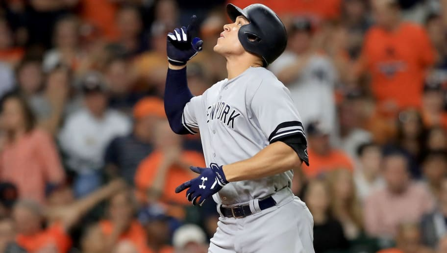 HOUSTON, TX - OCTOBER 20:  Aaron Judge #99 of the New York Yankees celebrates after hitting a solo home run against Brad Peacock #41 of the Houston Astros during the eighth inning in Game Six of the American League Championship Series at Minute Maid Park on October 20, 2017 in Houston, Texas.  (Photo by Ronald Martinez/Getty Images)