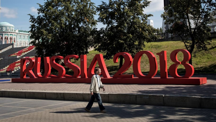 A man walks past a giant sign reading 'Russia 2018' in downtown Yekaterinburg, on August 19, 2017. The city of Yekaterinburg will host several games of the FIFA World Cup 2018. / AFP PHOTO / Mladen ANTONOV        (Photo credit should read MLADEN ANTONOV/AFP/Getty Images)