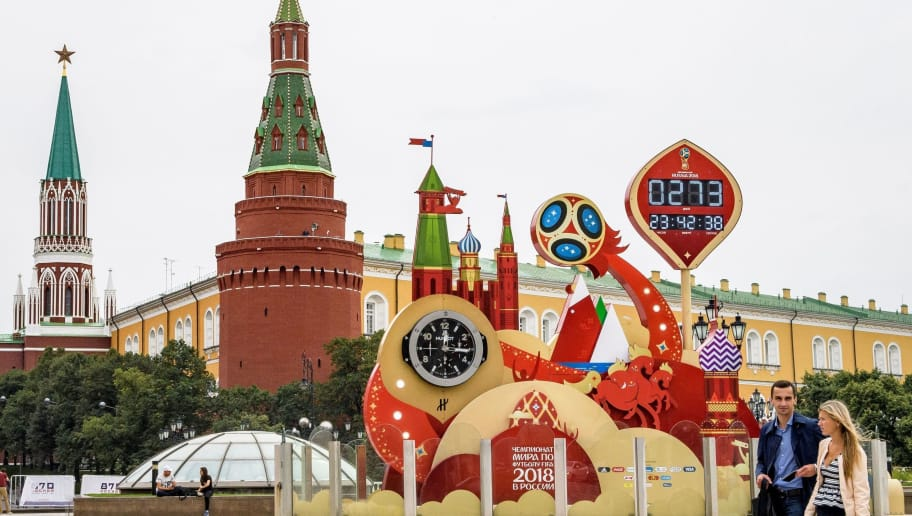 A couple walks in front of the digital FIFA World Cup 2018 countdown clock placed in front of the Red Square and the Kremlin in Moscow on September 13, 2017. FIFA announced that ticket sales for the 2018 World Cup will begin on September 14, 2017, nine months to the day ahead of the tournament's kicks off in Russia. The World Cup will be played at 12 venues in 11 Russian cities -- Moscow, Saint Petersburg, Sochi, Kazan, Saransk, Kaliningrad, Volgograd, Rostov-on-Don, Nizhny Novgorod, Yekaterinburg and Samara. / AFP PHOTO / Mladen ANTONOV        (Photo credit should read MLADEN ANTONOV/AFP/Getty Images)