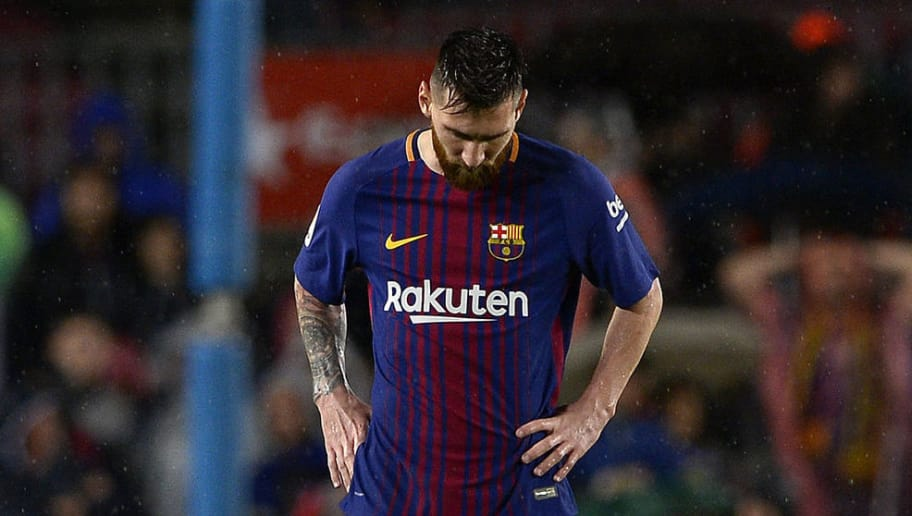 TOPSHOT - Barcelona's Argentinian forward Lionel Messi reacts during the Spanish league football match FC Barcelona vs Sevilla FC at the Camp Nou stadium in Barcelona on November 4, 2017.  / AFP PHOTO / Josep LAGO        (Photo credit should read JOSEP LAGO/AFP/Getty Images)