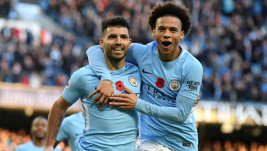 MANCHESTER, ENGLAND - NOVEMBER 05: Sergio Aguero of Manchester City celebrates scoring his sides second goal with Leroy Sane of Manchester City during the Premier League match between Manchester City and Arsenal at Etihad Stadium on November 5, 2017 in Manchester, England.  (Photo by Laurence Griffiths/Getty Images)