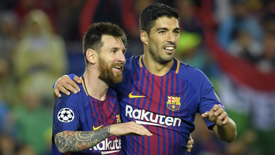 Barcelona's Argentinian forward Lionel Messi (L) and Barcelona's Uruguayan forward Luis Suarez celebrate Barcelona's  French defender Lucas Digne's goal during the UEFA Champions League group D football match FC Barcelona vs Olympiacos FC at the Camp Nou stadium in Barcelona on Ocotber 18, 2017. / AFP PHOTO / LLUIS GENE        (Photo credit should read LLUIS GENE/AFP/Getty Images)