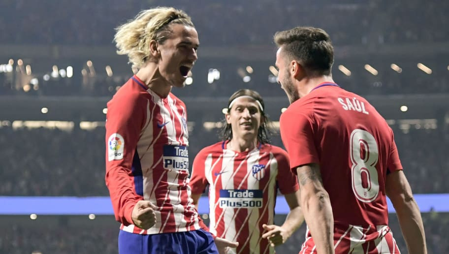 Atletico Madrid's Spanish midfielder Saul Niguez (R) celebrates a goal with Atletico Madrid's French forward Antoine Griezmann during the Spanish league football match Club Atletico de Madrid vs FC Barcelona at the Wanda Metropolitano stadium in Madrid on October 14, 2017. / AFP PHOTO / JAVIER SORIANO        (Photo credit should read JAVIER SORIANO/AFP/Getty Images)