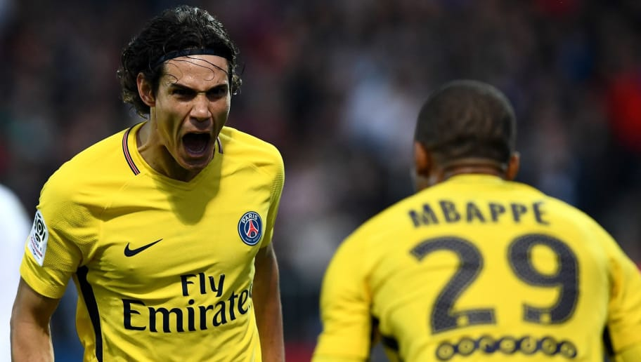Paris Saint-Germain's Uruguayan forward Edinson Cavani (L) celebrates after scoring a goal with Paris Saint-Germain's French forward Kylian Mbappe during the French L1 football match between Angers (SCO) and Paris Saint-Germain (PSG) at the Raymond Kopa Stadium in Angers, on November 4, 2017.  / AFP PHOTO / FRANCK FIFE        (Photo credit should read FRANCK FIFE/AFP/Getty Images)