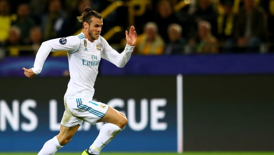 DORTMUND, GERMANY - SEPTEMBER 26:  Gareth Bale of Real Madrid runs with the ball during the UEFA Champions League group H match between Borussia Dortmund and Real Madrid at Signal Iduna Park on September 26, 2017 in Dortmund, Germany.  (Photo by Martin Rose/Bongarts/Getty Images)