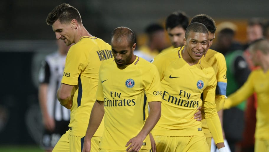 Paris Saint-Germain's French forward Kylian Mbappé (R) and Paris Saint-Germain's Brazilian midfielder Lucas (L) react after the French L1 football match between Angers (SCO) and Paris Saint-Germain (PSG) at the Raymond Kopa Stadium in Angers, on November 4, 2017.  / AFP PHOTO / JEAN-FRANCOIS MONIER        (Photo credit should read JEAN-FRANCOIS MONIER/AFP/Getty Images)