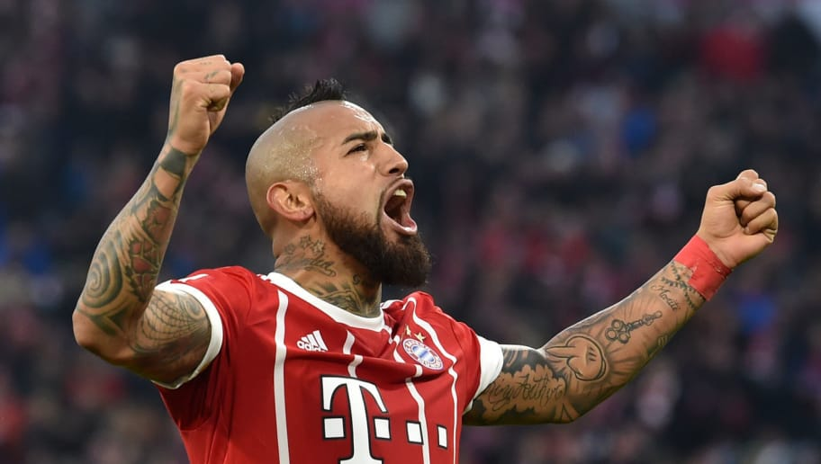 Bayern Munich's Chilean midfielder Arturo Vidal celebrates scoring the opening goal during the German first division Bundesliga football match Bayern Munich vs FC Augsburg in Munich, southern Germany, on November 18, 2017. / AFP PHOTO / Christof STACHE / RESTRICTIONS: DURING MATCH TIME: DFL RULES TO LIMIT THE ONLINE USAGE TO 15 PICTURES PER MATCH AND FORBID IMAGE SEQUENCES TO SIMULATE VIDEO. == RESTRICTED TO EDITORIAL USE == FOR FURTHER QUERIES PLEASE CONTACT DFL DIRECTLY AT + 49 69 650050         (Photo credit should read CHRISTOF STACHE/AFP/Getty Images)