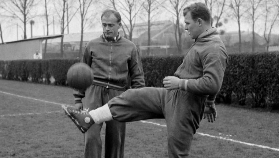 Hungarian-born forward Laszlo Kubala (R) juggles with the ball in front of Argentinian-born teammate Alfredo Di Stefano during Spain's national soccer team practice 12 March 1958 in Colombes, in the suburbs of Paris, on the eve of the soccer match against France.  AFP PHOTO        (Photo credit should read STAFF/AFP/Getty Images)