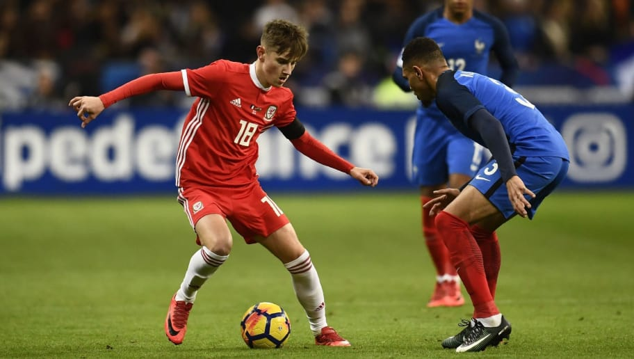 Wales' midfielder David Brooks vies for the ball with France's defender Layvin Kurzawa (R) during the friendly football match between France and Wales at the Stade de France stadium, in Saint-Denis, on the outskirts of Paris, on November 10, 2017. / AFP PHOTO / CHRISTOPHE SIMON        (Photo credit should read CHRISTOPHE SIMON/AFP/Getty Images)