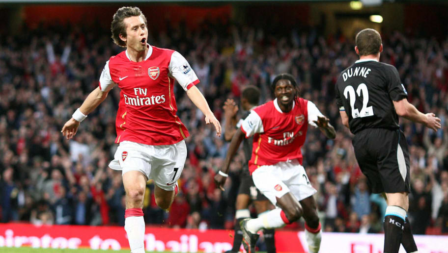 London, UNITED KINGDOM: Arsenal's Czech midfielder Tomas Rosicky (L) celebrates scoring  his side's opening goal, with team mate Emmanuel Adebayor (C)  as Manchester City's Richard Dunne (R) looks on, during the English Premiership match between Arsenal and Manchester City at the Emirates Stadium, London , 17 April  2007. AFP PHOTO/CHRIS YOUNG Mobile and website uses of domestic English football pictures subject to subscription of a licence with Football Association Premier League (FAPL) tel: +44 207 298 1656. For newspapers where the football content of the printed and electronic versions are identical, no licence is necessary. (Photo credit should read CHRIS YOUNG/AFP/Getty Images)