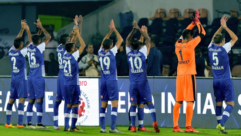 Bengaluru players celebrate with supporters their second goal during the Indian Super League (ISL) football match between Bengaluru FC and Mumbai City FC at Sree Kanteerava Stadium in Bangalore on November 19, 2017. / AFP PHOTO / Manjunath KIRAN / ----IMAGE RESTRICTED TO EDITORIAL USE - STRICTLY NO COMMERCIAL USE-----        (Photo credit should read MANJUNATH KIRAN/AFP/Getty Images)