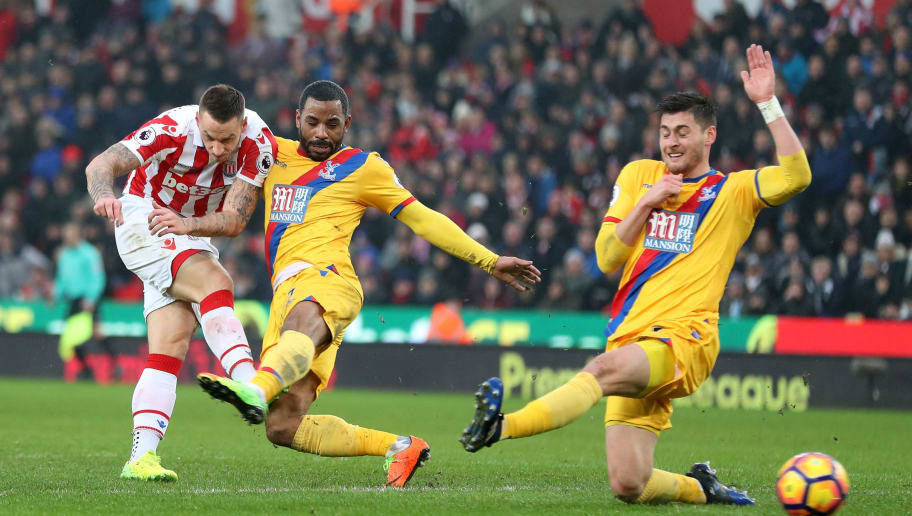 STOKE ON TRENT, ENGLAND - FEBRUARY 11:  Marko Arnautovic (L) of Stoke City shoots at goal while Jason Puncheon (C) and James Tomkins (R) of Crystal Palace try to block during the Premier League match between Stoke City and Crystal Palace at Bet365 Stadium on February 11, 2017 in Stoke on Trent, England.  (Photo by Mark Robinson/Getty Images)