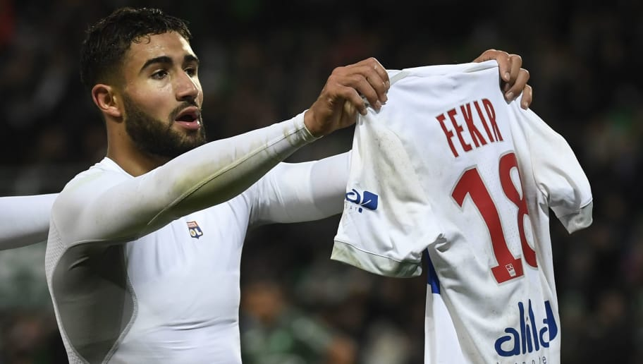 Lyon's French midfielder Nabil Fekir shows his shirt after scoring during the French L1 football match between AS Saint-Etienne and Olympique Lyonnais, on November 5, 2017, at the Geoffroy Guichard stadium in Saint-Etienne, central France.    / AFP PHOTO / PHILIPPE DESMAZES        (Photo credit should read PHILIPPE DESMAZES/AFP/Getty Images)