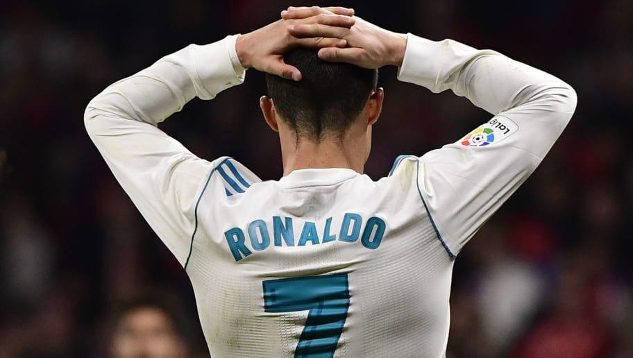 Real Madrid's Portuguese forward Cristiano Ronaldo gestures during the Spanish league football match Atletico Madrid vs Real Madrid at the Wanda Metropolitan stadium in Madrid on November 18, 2017. / AFP PHOTO / PIERRE-PHILIPPE MARCOU        (Photo credit should read PIERRE-PHILIPPE MARCOU/AFP/Getty Images)