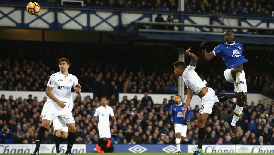 LIVERPOOL, ENGLAND - NOVEMBER 19: Yannick Bolasie of Everton (R) climbs above Kyle Naughton of Swansea City (R) to win a header during the Premier League match between Everton and Swansea City at Goodison Park on November 19, 2016 in Liverpool, England.  (Photo by Jan Kruger/Getty Images)
