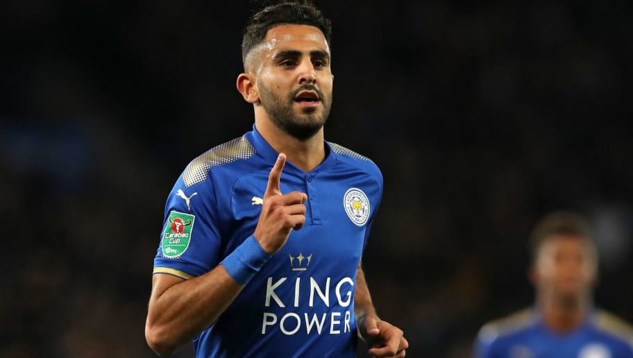 Leicester City's Algerian midfielder Riyad Mahrez celebrates after scoring their third goal during the English League Cup fourth round football match between Leicester City and Leeds United at King Power Stadium in Leicester, central England on October 24, 2017. Leicester won the game 3-1. / AFP PHOTO / Lindsey PARNABY / RESTRICTED TO EDITORIAL USE. No use with unauthorized audio, video, data, fixture lists, club/league logos or 'live' services. Online in-match use limited to 75 images, no video emulation. No use in betting, games or single club/league/player publications.  /         (Photo credit should read LINDSEY PARNABY/AFP/Getty Images)