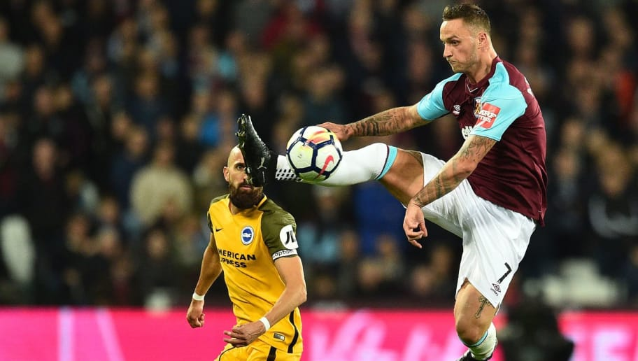 West Ham United's Austrian midfielder Marko Arnautovic (R) controls the ball as Brighton's Spanish defender Bruno Saltor looks on during the English Premier League football match between West Ham United and Brighton and Hove Albion at The London Stadium, in east London on October 20, 2017. / AFP PHOTO / Glyn KIRK / RESTRICTED TO EDITORIAL USE. No use with unauthorized audio, video, data, fixture lists, club/league logos or 'live' services. Online in-match use limited to 75 images, no video emulation. No use in betting, games or single club/league/player publications.  /         (Photo credit should read GLYN KIRK/AFP/Getty Images)