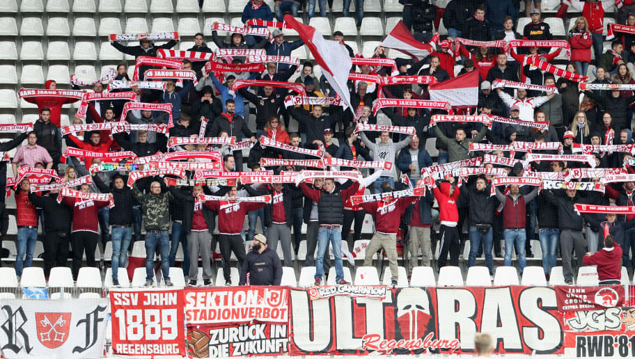AUE, GERMANY - OCTOBER 22:  Fans of Regensburg with scarves during the Second Bundesliga match between FC Erzgebirge Aue and SSV Jahn Regensburg at Sparkassen-Erzgebirgsstadion on October 22, 2017 in Aue, Germany. (Photo by Karina Hessland-Wissel/Bongarts/Getty Images)