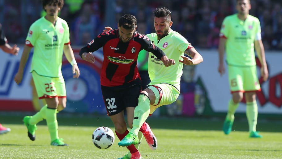 FREIBURG IM BREISGAU, GERMANY - APRIL 08: Vincenzo Griffo (2ndL) of Freiburg fights for the ball with Danny Latza (R) of Mainz during the Bundesliga match between SC Freiburg and 1. FSV Mainz 05 at Schwarzwald-Stadion on April 8, 2017 in Freiburg im Breisgau, Germany.  (Photo by Thomas Niedermueller/Bongarts/Getty Images)
