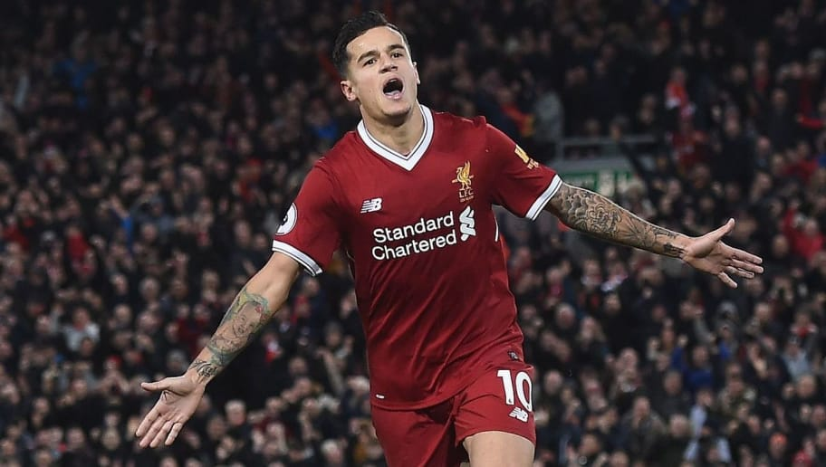 Liverpool's Brazilian midfielder Philippe Coutinho celebrates scoring his team's third goal during the English Premier League football match between Liverpool and Southampton at Anfield in Liverpool, north west England on November 18, 2017. / AFP PHOTO / PAUL ELLIS / RESTRICTED TO EDITORIAL USE. No use with unauthorized audio, video, data, fixture lists, club/league logos or 'live' services. Online in-match use limited to 75 images, no video emulation. No use in betting, games or single club/league/player publications.  /         (Photo credit should read PAUL ELLIS/AFP/Getty Images)