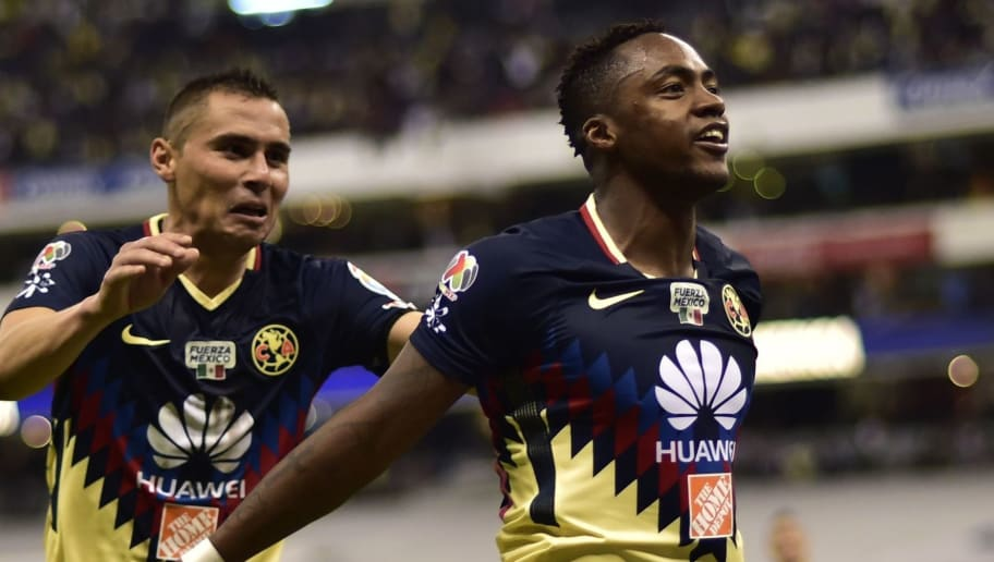 America's Ecuatorian forward Alex Ibarra (R) celebrates with his teammate Paul Aguilar after scoring a goal against Guadalajara during their Mexican Apertura tournament football match at the Azteca stadium on October 18, 2017 in Mexico City. / AFP PHOTO / PEDRO PARDO        (Photo credit should read PEDRO PARDO/AFP/Getty Images)