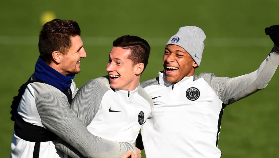 (L/R): Paris Saint-Germain's Belgian defender Thomas Meunier, Paris Saint-Germain's German midfielder Julian Draxler and Paris Saint-Germain's French forward Kylian Mbappe share a light moment during a training session at Saint-Germain-en-Laye, western Paris on October 30, 2017, on the eve of the UEFA Champions League football match against Anderlecht.   / AFP PHOTO / FRANCK FIFE        (Photo credit should read FRANCK FIFE/AFP/Getty Images)