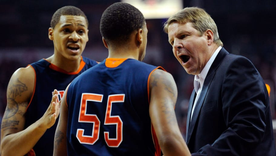 LAS VEGAS, NV - DECEMBER 14:  Head coach Tim Floyd of the UTEP Miners talks to his players Gabriel McCulley #23 and D'Von Campbell #55 during their game against the UNLV Rebels at the Thomas & Mack Center December 14, 2011 in Las Vegas, Nevada. UNLV won 65-54.  (Photo by Ethan Miller/Getty Images)