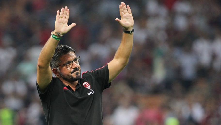 MILAN, ITALY - AUGUST 27:  AC Milan juvenile coach Gennaro Gattuso salute the crowd during the Serie A match between AC Milan and Cagliari Calcio at Stadio Giuseppe Meazza on August 27, 2017 in Milan, Italy.  (Photo by Marco Luzzani/Getty Images)