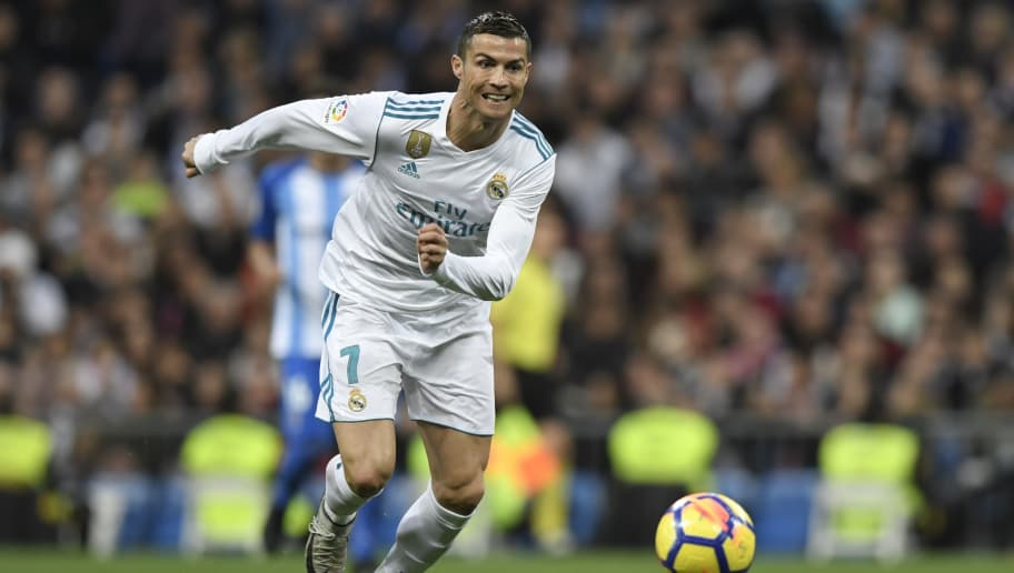 Real Madrid's Portuguese forward Cristiano Ronaldo runs for the ball during the Spanish league football match Real Madrid CF against Malaga CF on 25, November 2017 at the Santiago Bernabeu stadium in Madrid. / AFP PHOTO / GABRIEL BOUYS        (Photo credit should read GABRIEL BOUYS/AFP/Getty Images)