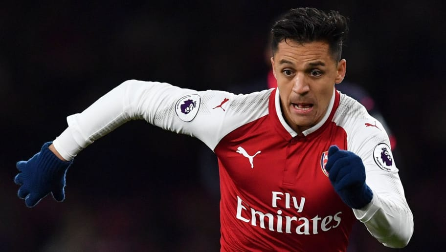 Arsenal's Chilean striker Alexis Sanchez runs with the ball during the English Premier League football match between Arsenal and Huddersfield Town at the Emirates Stadium in London on November 29, 2017.  / AFP PHOTO / Ben STANSALL / RESTRICTED TO EDITORIAL USE. No use with unauthorized audio, video, data, fixture lists, club/league logos or 'live' services. Online in-match use limited to 75 images, no video emulation. No use in betting, games or single club/league/player publications.  /         (Photo credit should read BEN STANSALL/AFP/Getty Images)