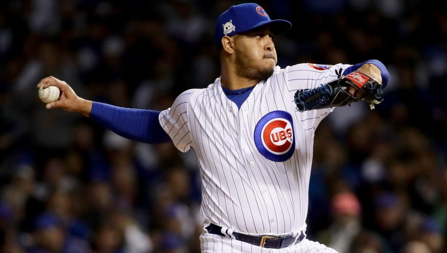 CHICAGO, IL - OCTOBER 19:  Hector Rondon #56 of the Chicago Cubs pitches in the third inning against the Los Angeles Dodgers during game five of the National League Championship Series at Wrigley Field on October 19, 2017 in Chicago, Illinois.  (Photo by Jonathan Daniel/Getty Images)